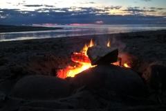 Fire on beach by Maketu Surf Club